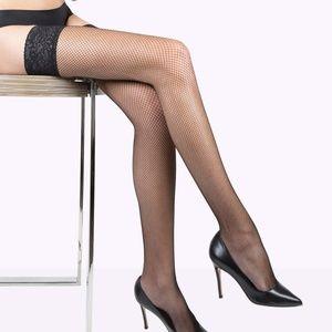 Black fishnet stockings, thigh highs